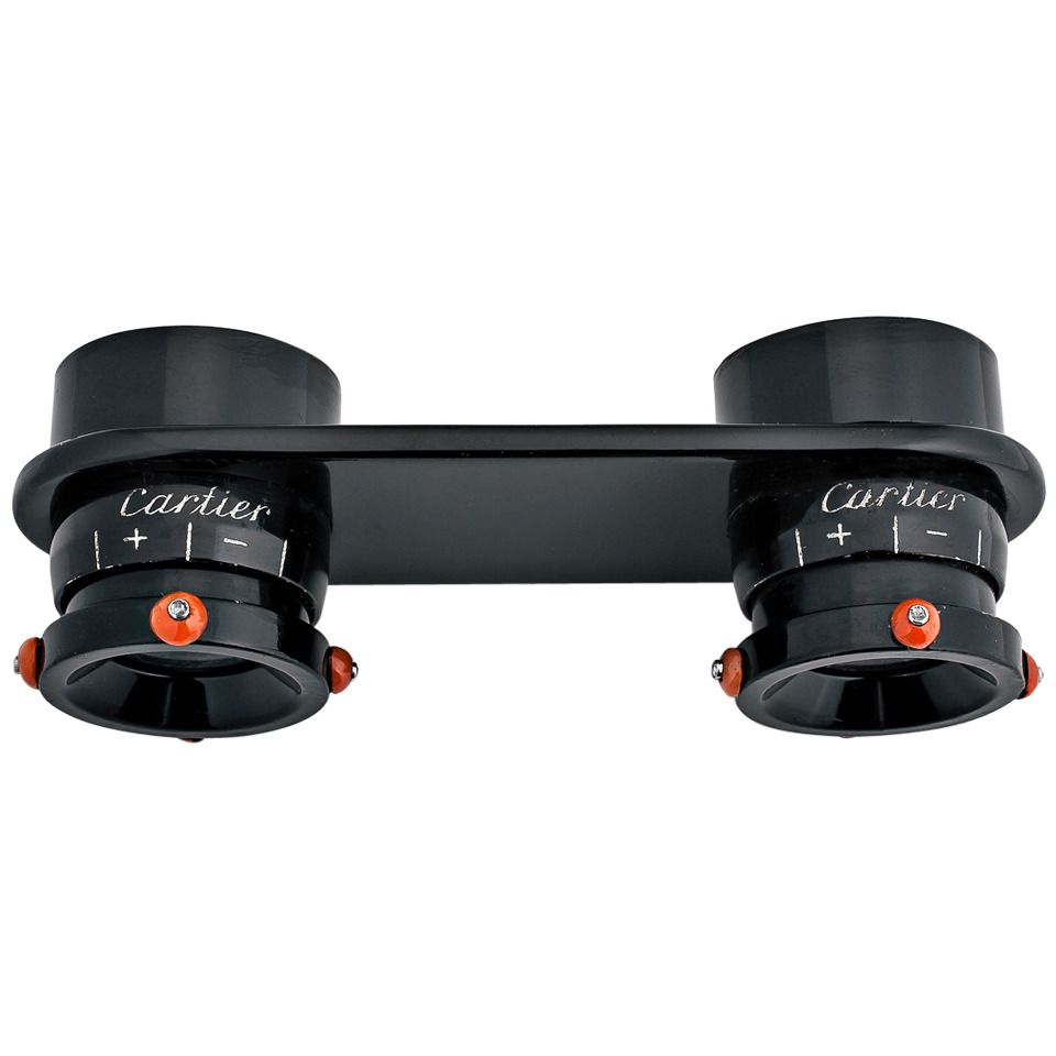 Cartier Paris Art Deco Black Lacquer Coral Diamond Binoculars. Having binocular vision is now possible with these Art Deco, circa 1930, black lacquer one-of-a-kind spectacles. Trimmed with coral beads topped with collet set diamonds, this signed Cartier pair of 'opera glasses' is fully operational and so sleek that they could be mistaken for a collectible piece of contemporary sculpture. Stamped with Cartier serial #92176.