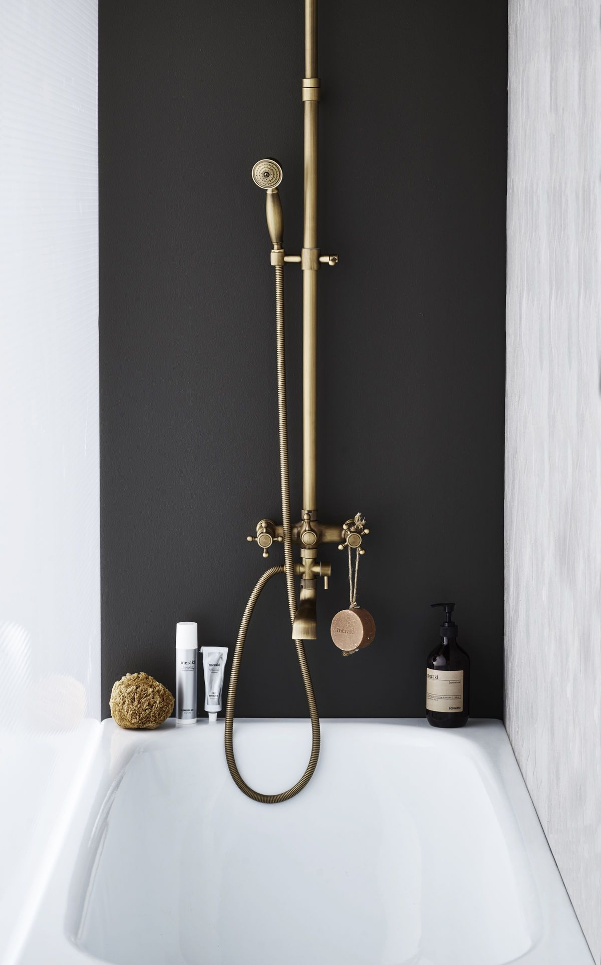 Dark accent wall in shower. Bathroom interior design inspiration