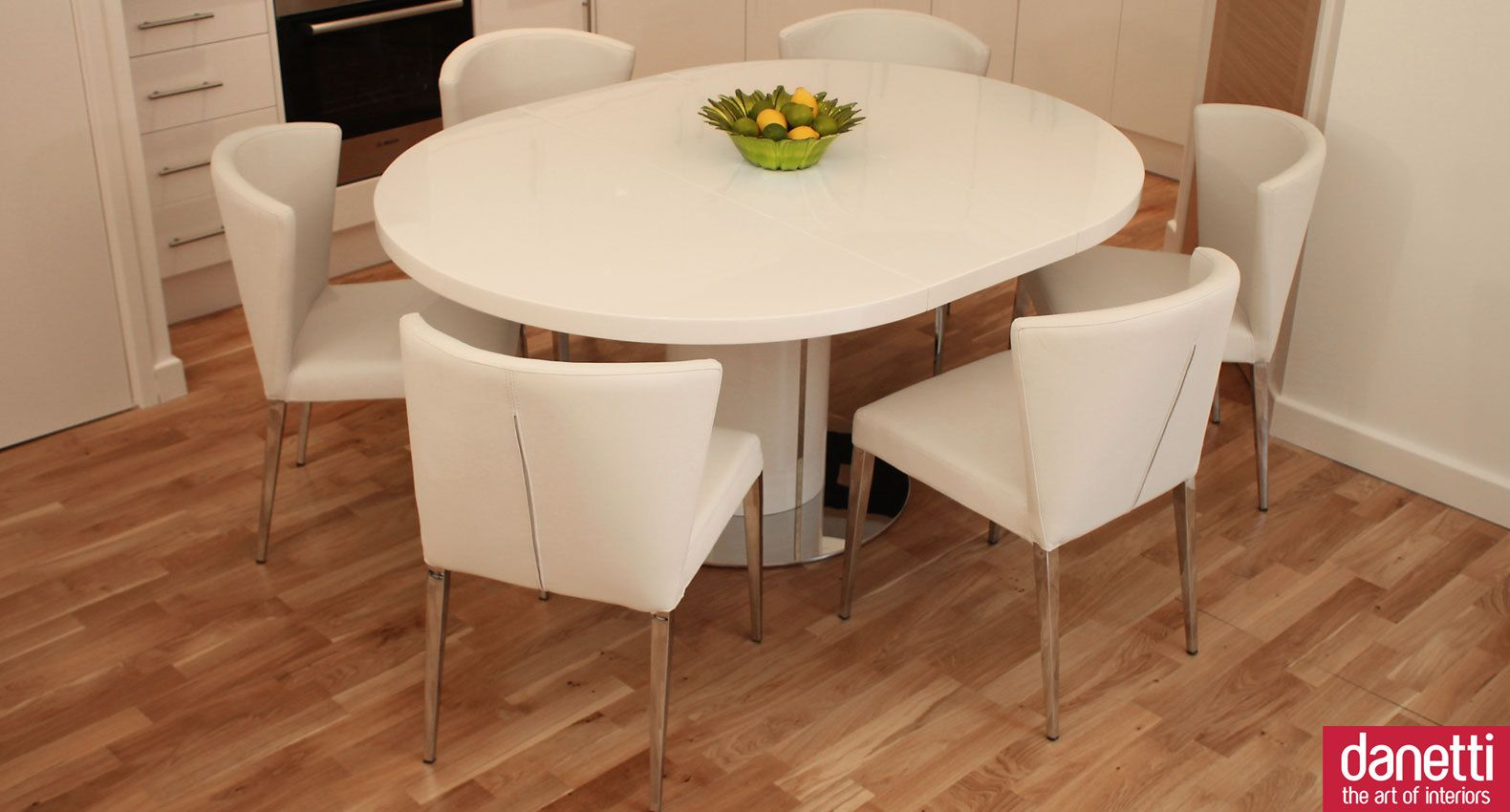 Curva White Gloss Extending Dining Set Oval dining tables