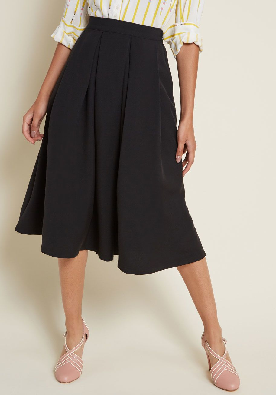 30500cca62 The satisfying spin of its full skirt, the deep pockets, the timeless  pleats - yup, this black midi skirt is vintage inspired, through and  through! An..