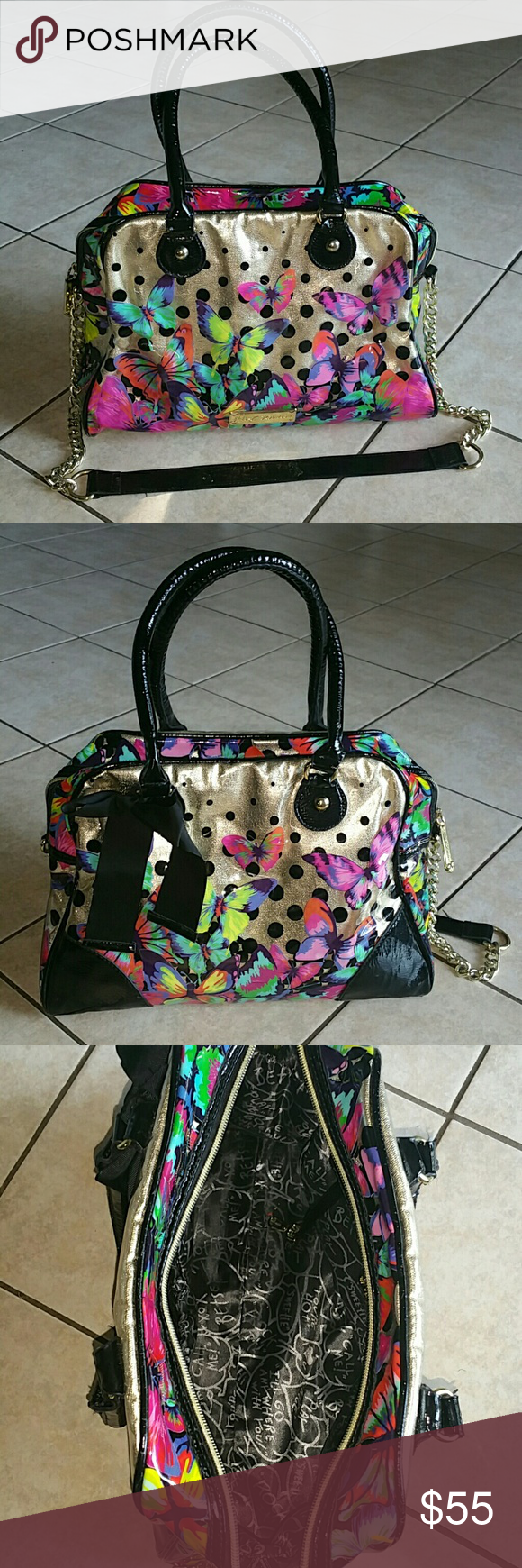Betsey Johnson purse Beautiful bright butterflies on clear vynel, background is gold. Inside has black and white lining with different phrases. One zippered co.partment inside, two smaller pockets. Handles have a small amount of wear but in overall good condition. Shoulder strap is in great condition. Measurements are: 13.5 inches across, 10 inches on height, 5 inches on sides. Betsey Johnson Bags Shoulder Bags
