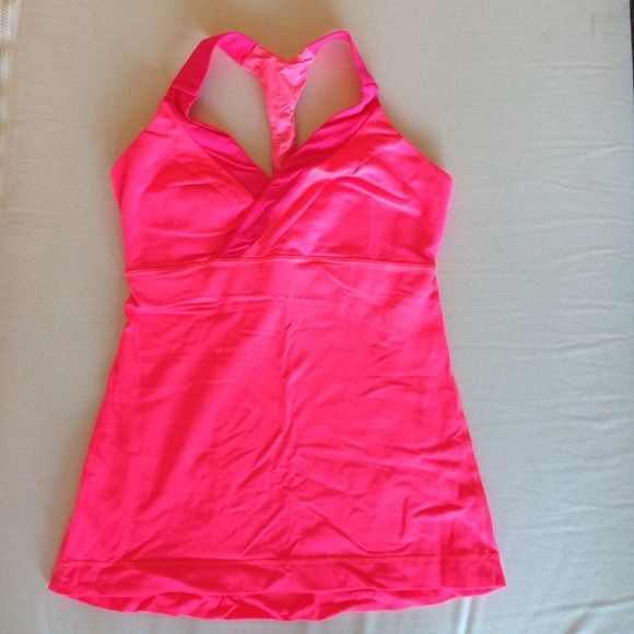 NWOT Lululemon Hot Pink Deep Breath V Neck Tank 4 NWOT! RARE hard-to-find, sold out color and style. Beautiful hot pink tank! Like new - only worn once! The color is a bright neon highlighter-like color, sort of an orangish pink. The V Neck is very flattering. Super cute! The material is Luon. There are slots for cups - I can include cups if you ask. Happy poshing! lululemon athletica Tops Tank Tops