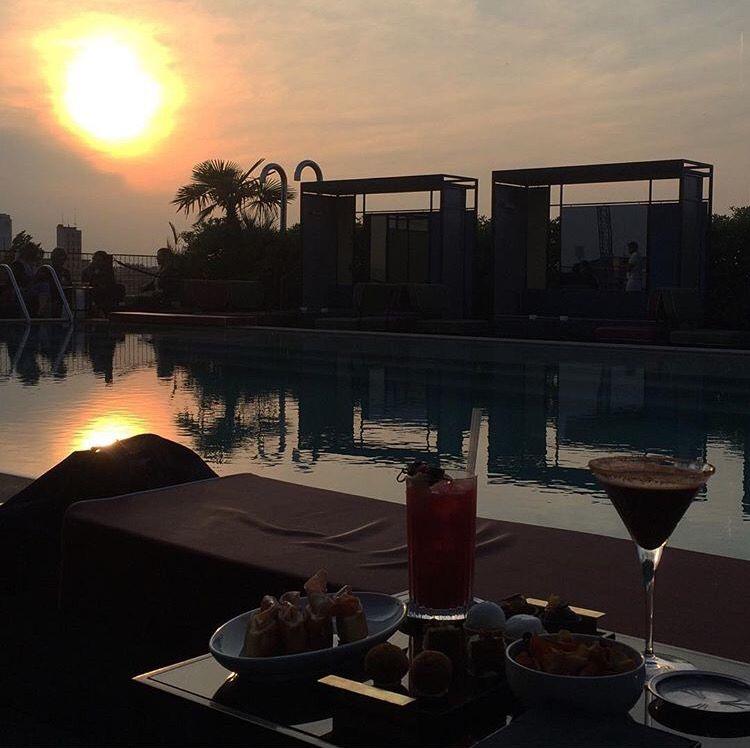 Sunset rooftop pool bar, Milan