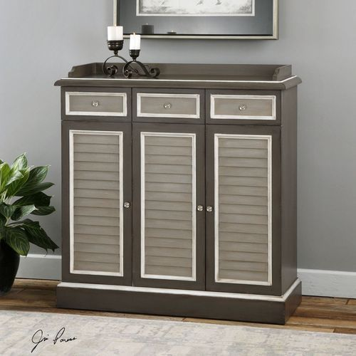 The Prospera Shuttered Grey Buffet is the perfect bar for your next beach party with its gorgeous shuttered doors, interior glassware hangers and wine storage shelves, and nickel hardware. This beautiful piece of furniture is a nicely scaled sideboard in warm grey.