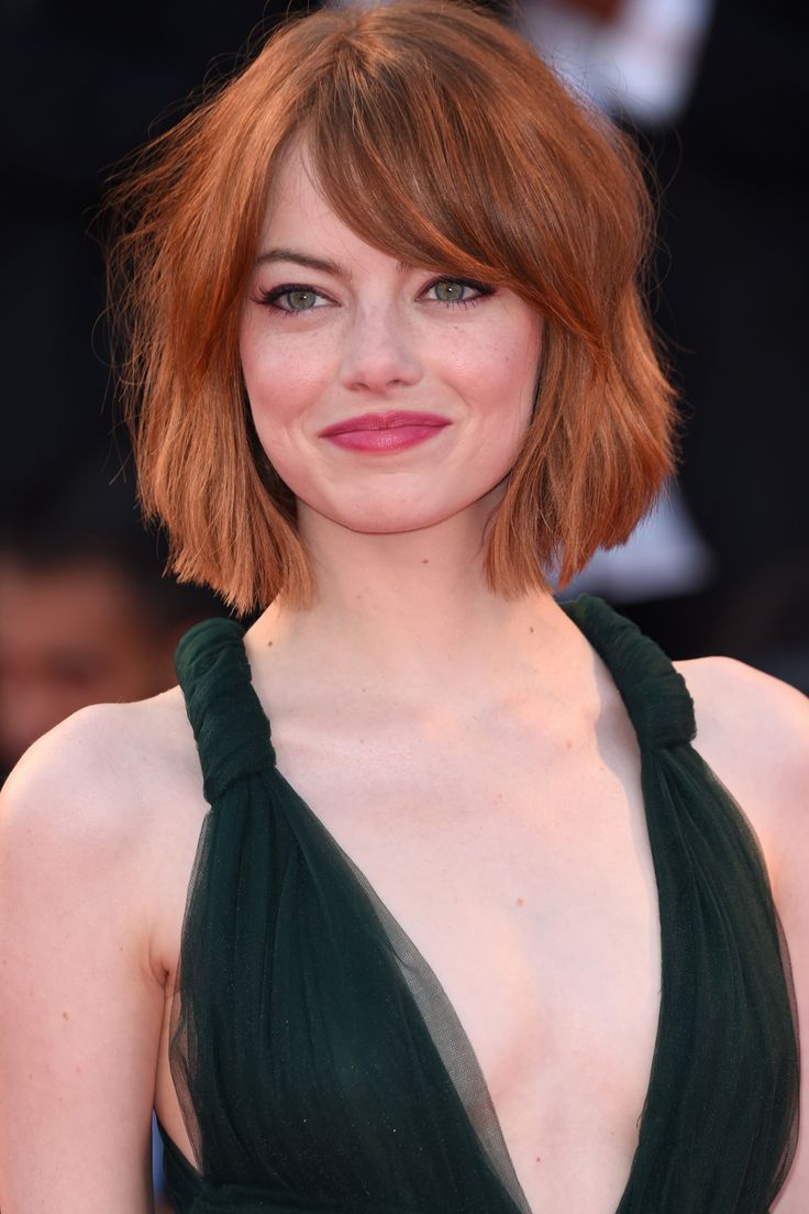 emma stone with a voluminous bob and fringe - hairstyles for round