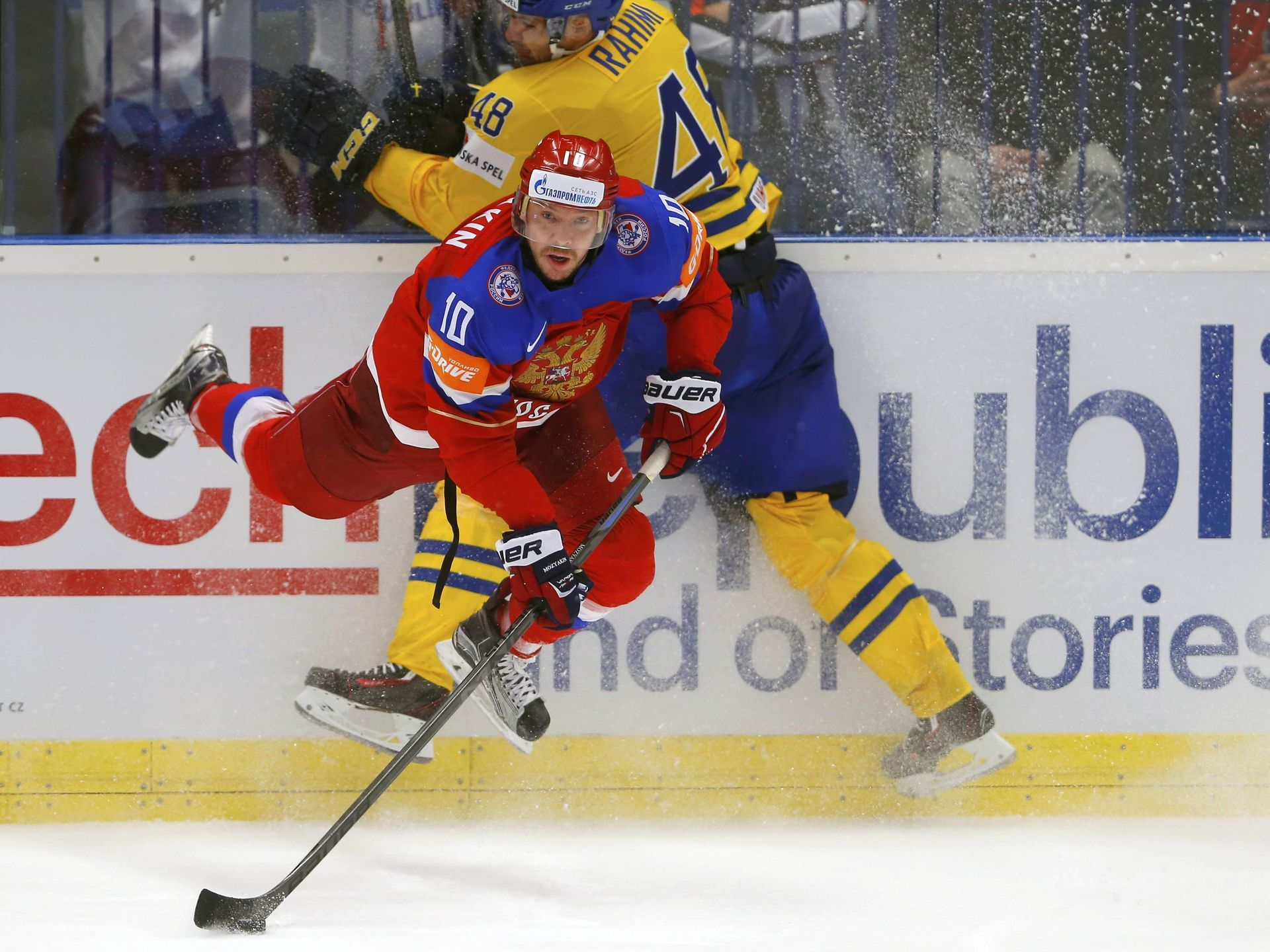 Russia's Sergei Mozyakin prepares to shoot past Sweden's Daniel Rahimi, top, during their Ice Hockey World Championship quarterfinals game in Ostrava, Czech Republic.  Laszlo Balogh, Reuters