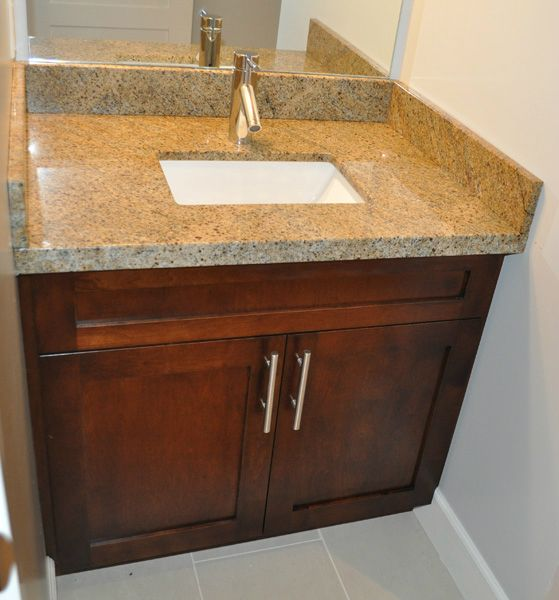 Washroom vanity and granite countertop. www.phoenixmillwork.ca