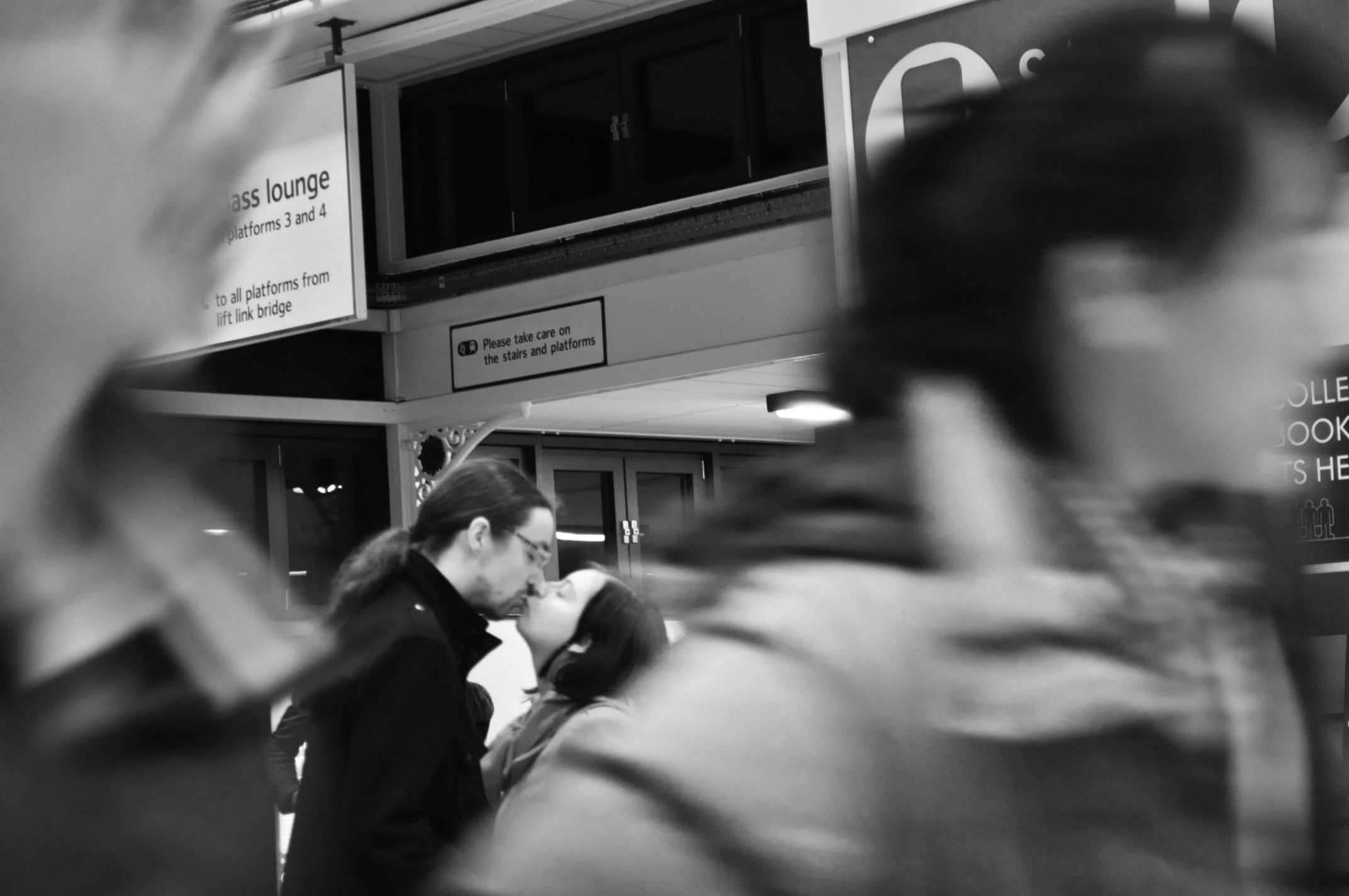 This photography is mine, I made it practicing candid moment photography at the train station. :)