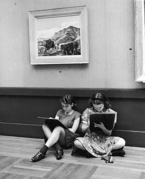 Alfred Eisenstaedt: Two teenagers sit againtst a wall sketching in the Toledo Museum of Art. Toledo, Ohio, 1939.    Found in the LIFE archive.