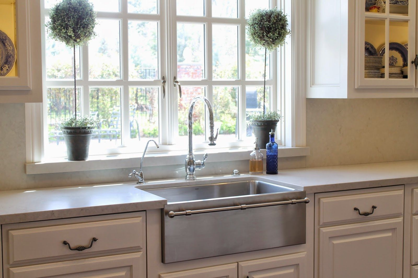 For her kitchen remodel, Emily of Eleven Gables chose a contemporary take on the traditional enamel farmhouse sink: a Blanco Magnum in stainless steel with a built-in towel bar.