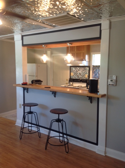 The Wall Between The Living Room And Kitchen Was Opened And A Bar Height Eating Counter Was Added Tr Open Kitchen And Living Room Kitchen Bar Home Bar Counter