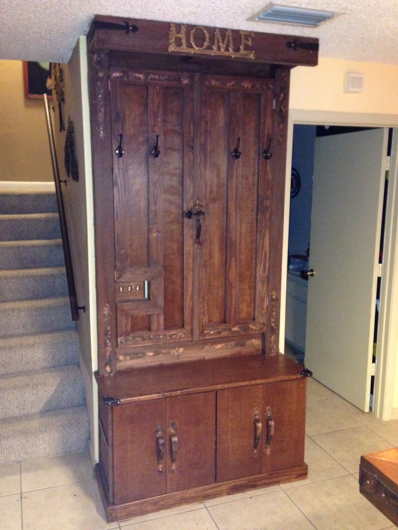 Hiding electric fuse box with a hall tree cabinet !