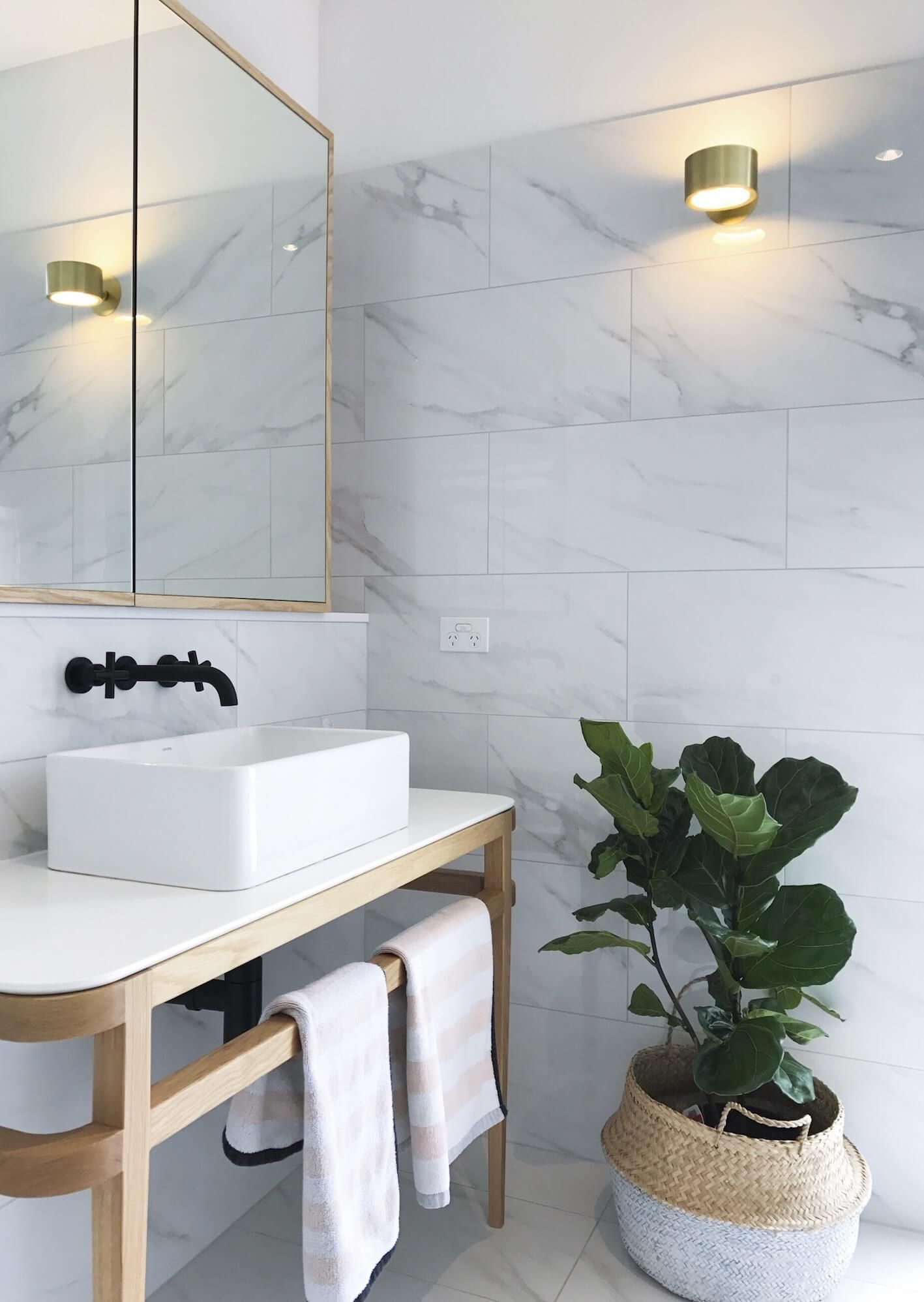 These bathrooms are simple yet sophisticated, drawing on oak and ...