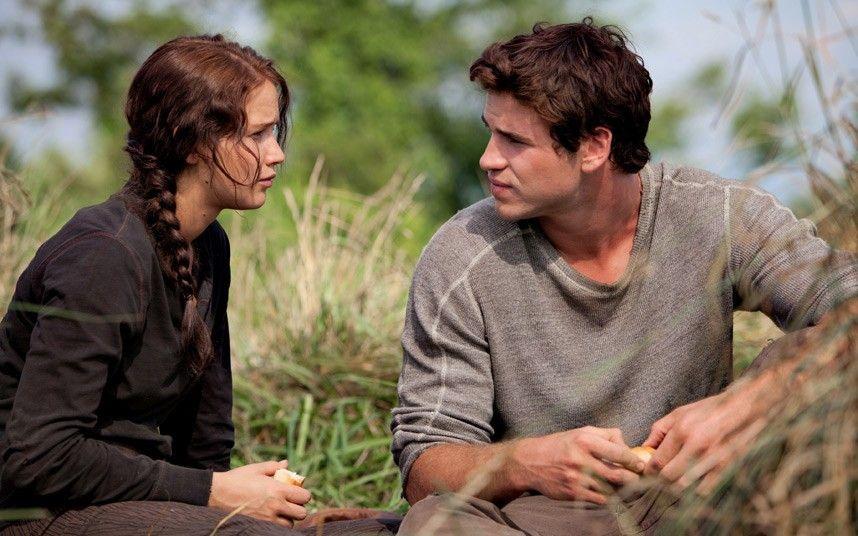 Katniss (Jennifer Lawrence) and Gale (Liam Hemsworth)