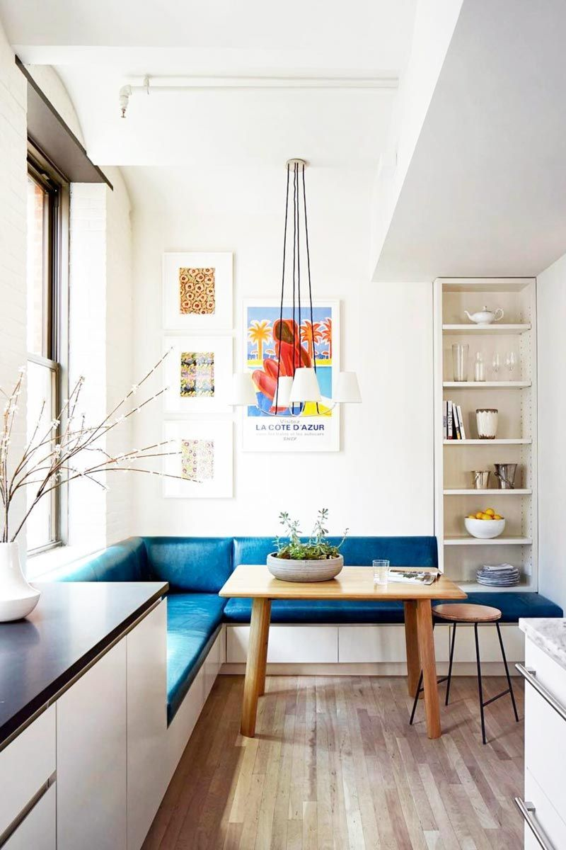 Blue dining banquette in modern kitchen design on Thou Swell