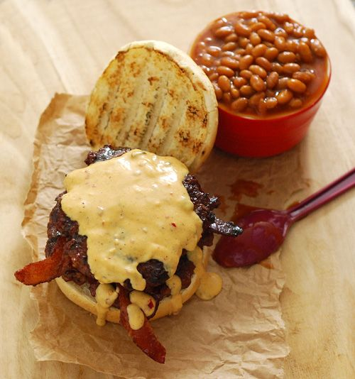 Candied Bacon Cheese Burger - Burger with candied bacon and a spicy cheese sauce.