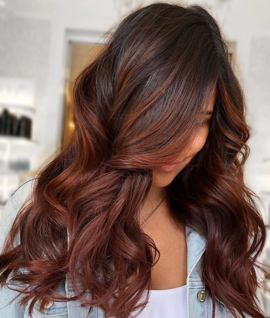 Looking To Warm Up Your Hue For Fall Read On To See Why We Re Loving Cinnamon Brown Hair Cinnamon Brown Hair Color Dark Hair With Highlights Hair Color Auburn