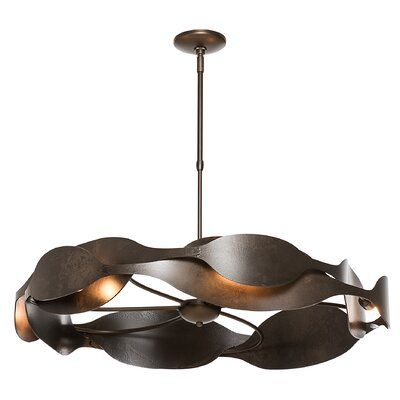 Hubbardton Forge With a sensual interplay of light and shadow, the waves pendant suggests a fluidity of motion, an eternal circle of life. Heavily textured steel showcases the skill of the American metal crafters and artisans at the forge. Finish: Vintage Platinum, Size: 35.2