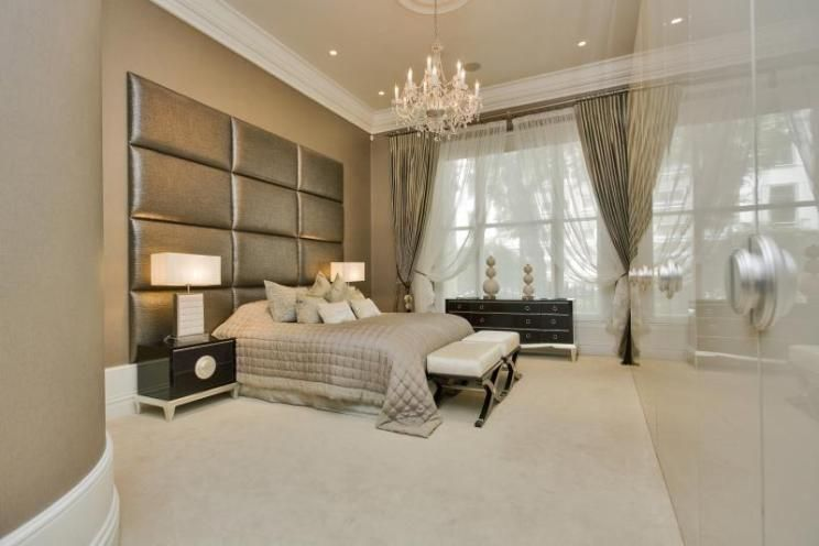 photo of contemporary modern beige gold bedroom with chandelier