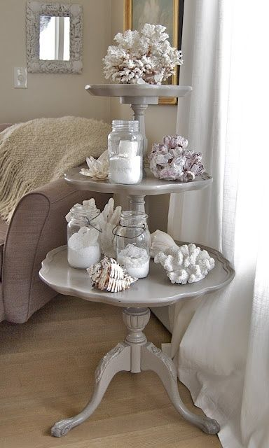 Seashells on a tiered table in a beach house
