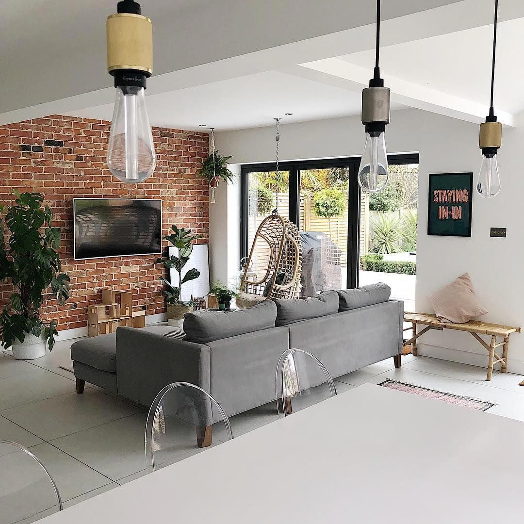 A Fresh Light And Airy Living Room With Exposed Brick Wall Large Grey Sofa And Patio Doors Out Onto The Garden Livingroom Fro