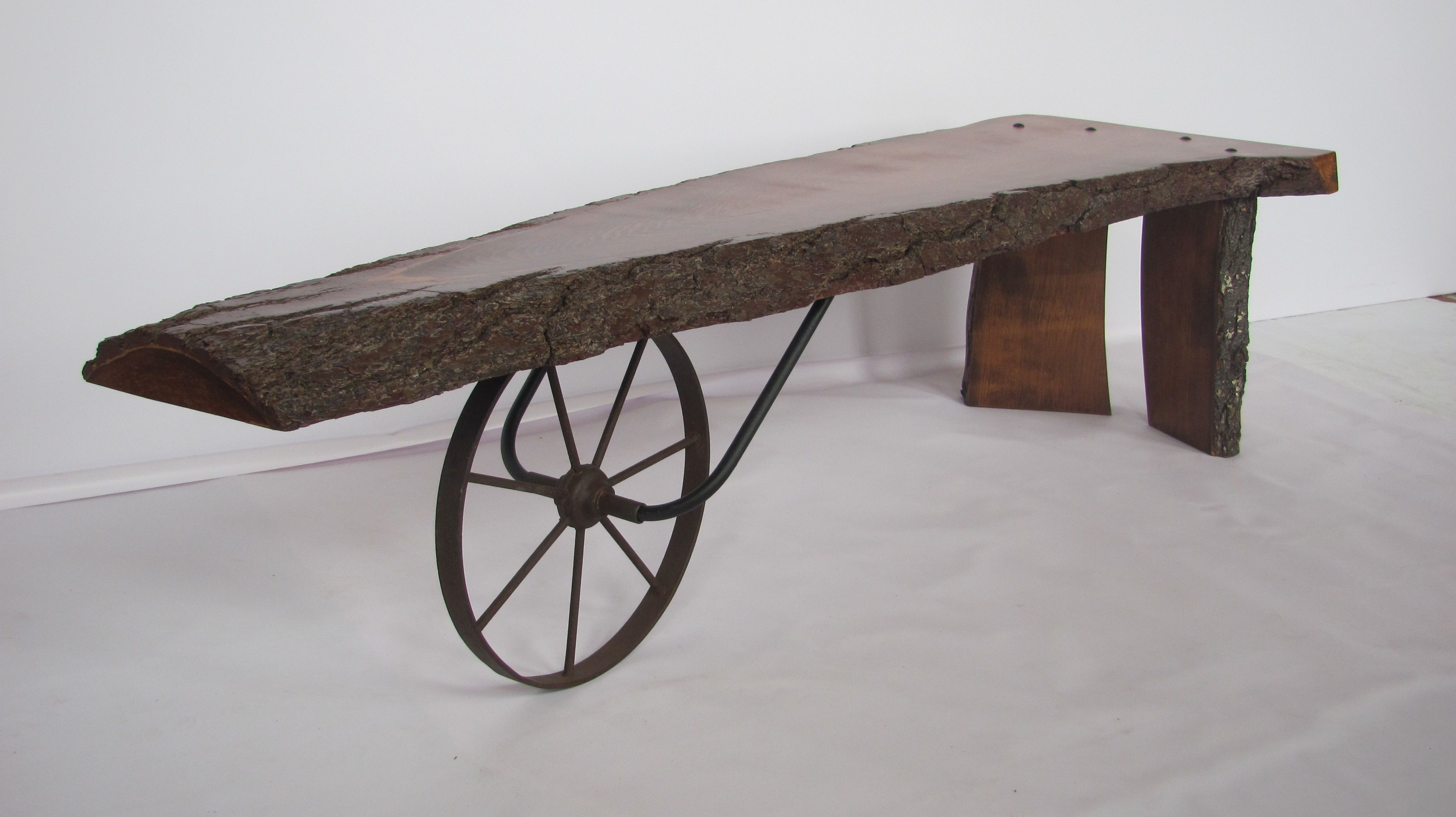 Unique Rustic Table Made from Wagon Wheel and Tree Stumps