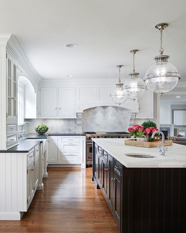 Island Countertop Is A Calacatta Marble The Perimeter Countertop Is A Soapstone And The Black Kitchen Countertops Gorgeous White Kitchen Luxury Kitchen Design