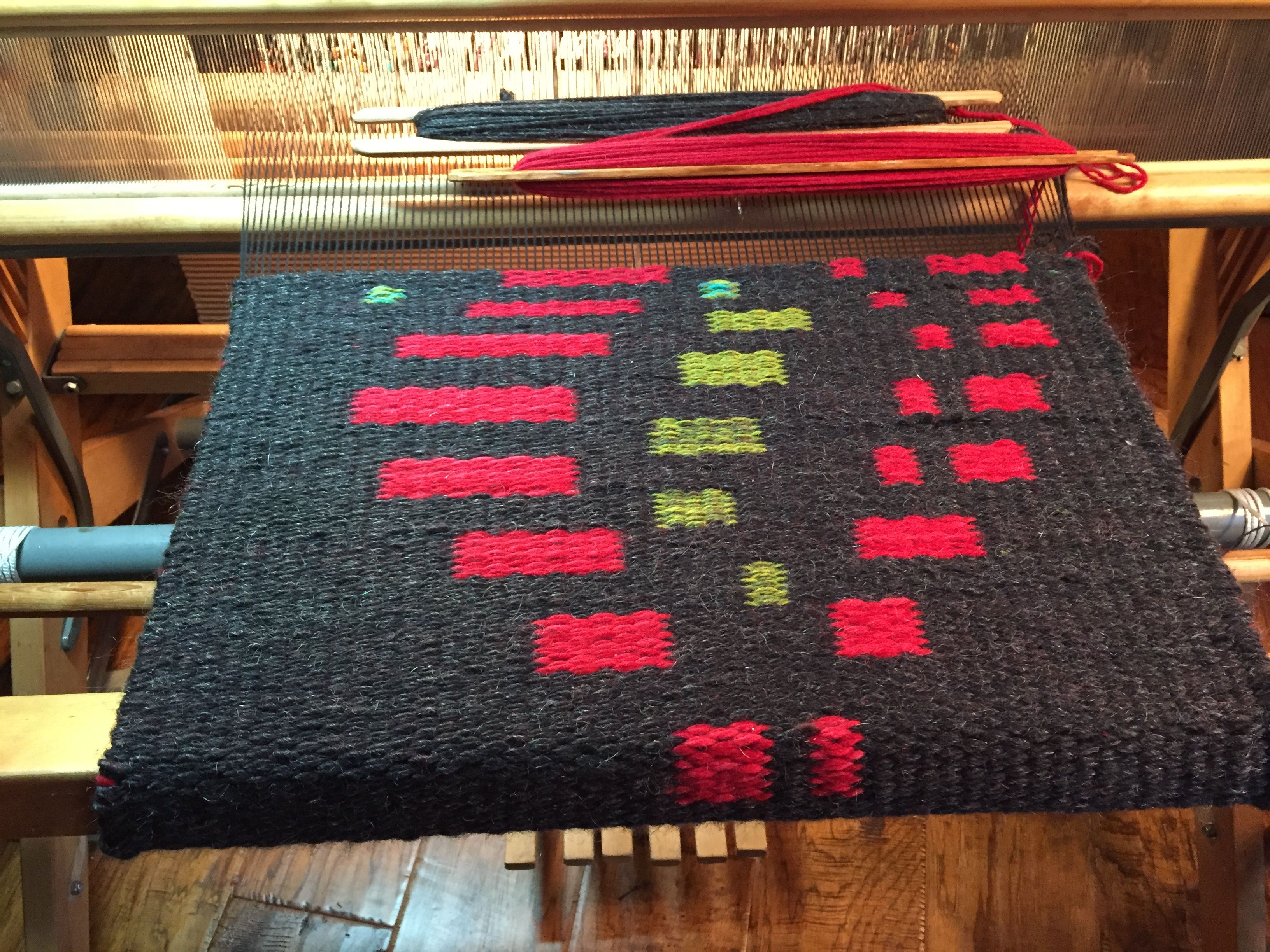 The Beginning Of A Hand Woven Shaft Switching Wool Rug