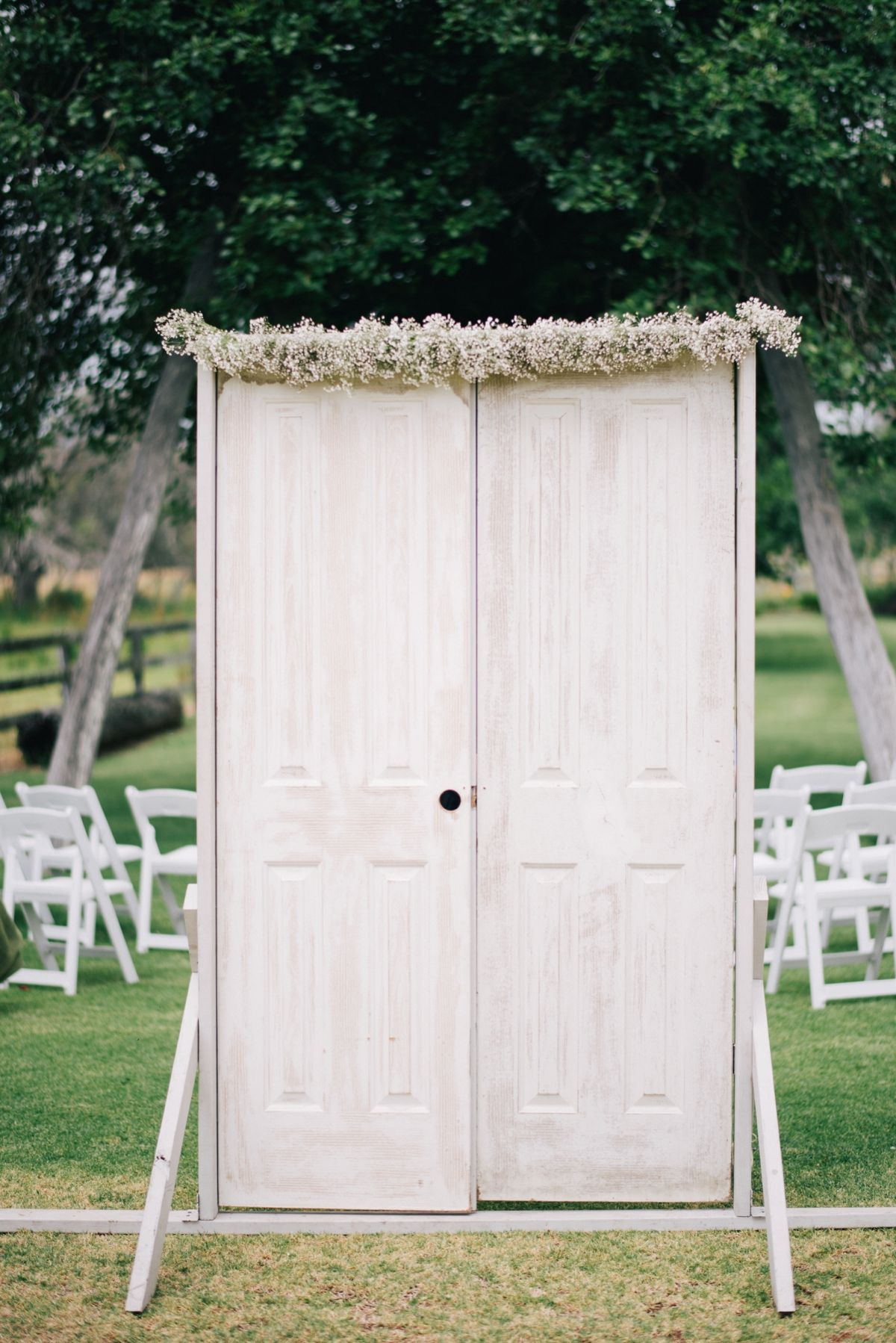 Welcome doors at Alverstoke Barn, Brunswick (Western Australia). Baby's breath garland by Scentiment Flowers, pic by Ben Yew Photography.
