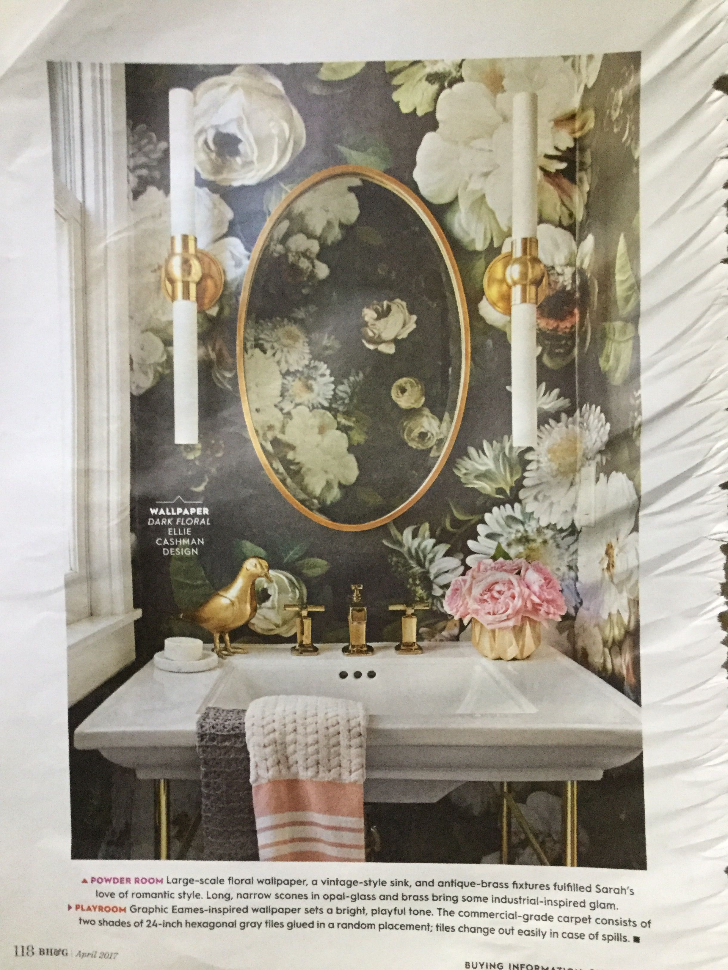 Large scale floral wallpaper and a vintage sink in the
