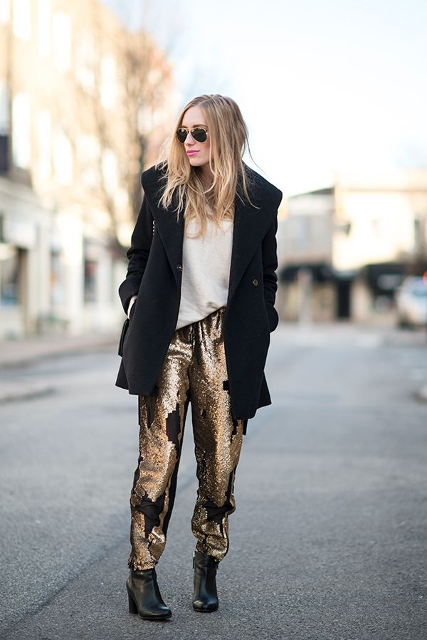 f6e732e1 11 cool girl new year's eve outfit ideas - cream top, black winter coat,  gold sequin trousers + black ankle boots