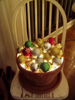 Lighted Ornament Balls    Terra Cotta Pot filled with tiny white light string and shiny ornaments.