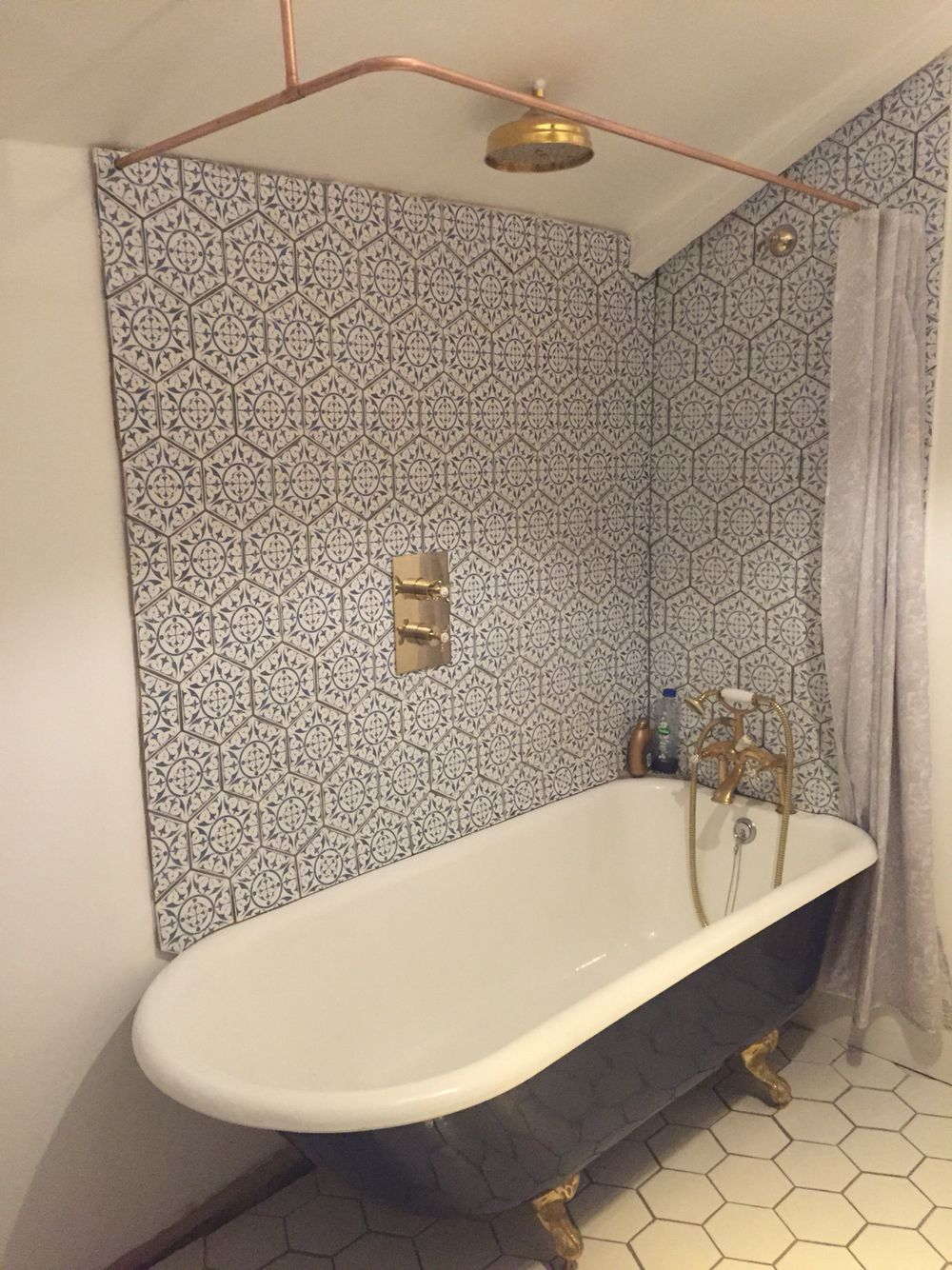 Cast Iron Bath With Copper Shower Curtain Rail Hexagon Tiles In
