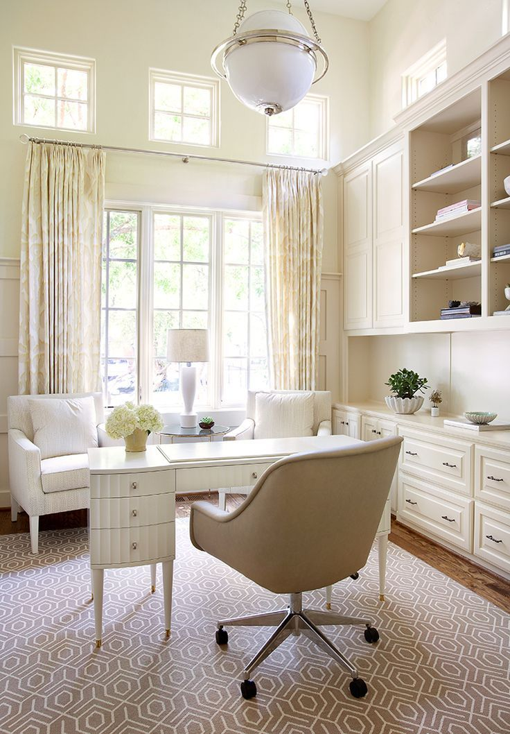 A chic home office design with a white, beige, and cream color ...