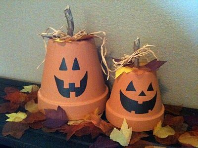 this i can do! :)  Super easy cute decor... Pumpkin Terracotta pots. I want to make these except flipped with a fall plant in it...