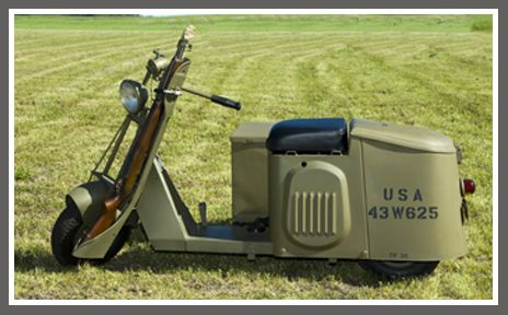 This Cushman Motor Scooter was made for WW2 Airborne troops. The rugged, simple Model 32 was designed to travel through a foot of water, climb a 25 percent grade and had a range of about 100 miles. (I want one!)