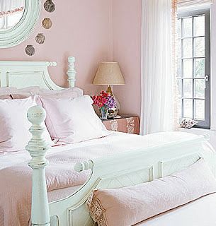 Feminine bedroom in pretty pastels...love the timber bed colour...source: Country Homes & Interiors...