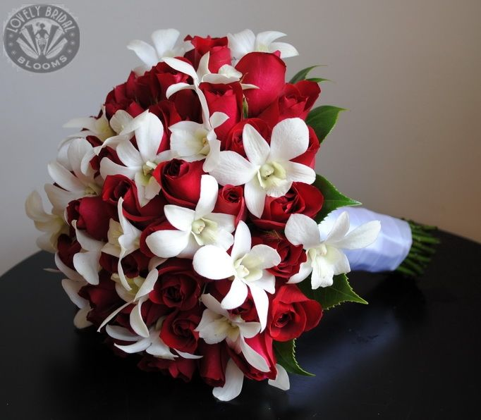 Red Roses And White Singapore Orchids