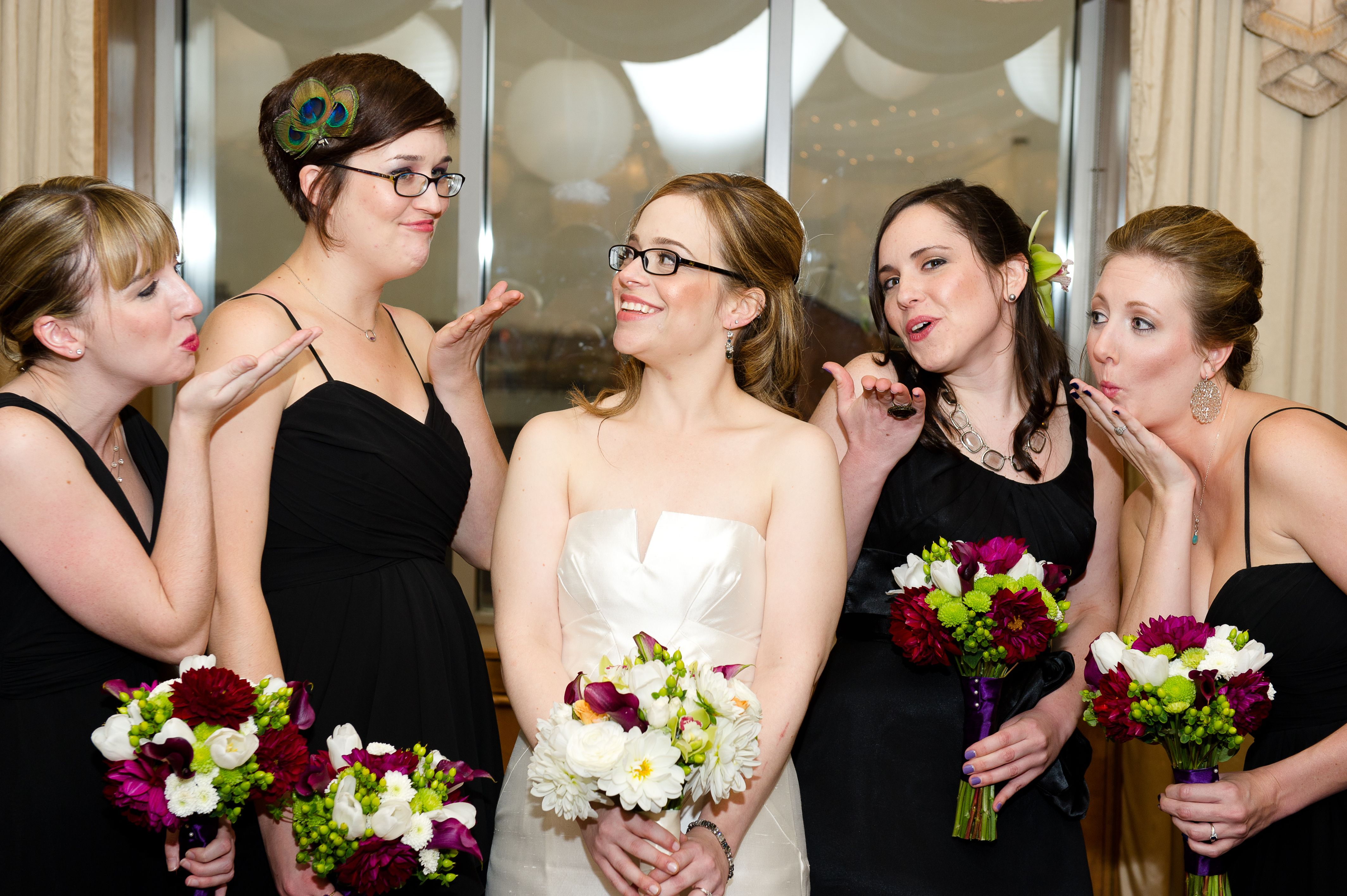 My girls wore black chiffon dresses from the Watters collection provided by Betsy Robinson's Bridal in Pikesville. They wore their own jewelry. Amy wore a peacock fascinator in her hair that we purchased at Lovely Bridal. Michele and Beth each wore an oversized lime cymbidium orchid in their hair. Each girl wore her choice of colorful open-toed pumps. Florals by Divine Designs and Events.
