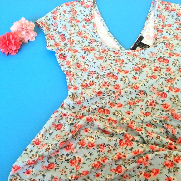Criss Cross Dress Super Cute Criss Cross Dress. This dress is light blue with a floral pattern. Ladies this is a cute on the go dress for summer. Pair this dress with sandals and a top knot bun. Forever 21 Dresses
