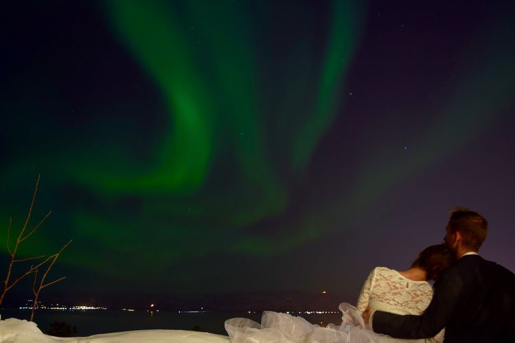 Taking in the northern lights - Alta, Norway - See more of our wanderlust wedding photos on our blog www.travelwheretonext.com