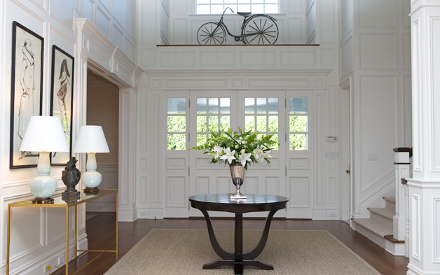 Suzie: Ken Gemes Interiors - Chic traditional foyer entrance design with sisal rug, espresso ...