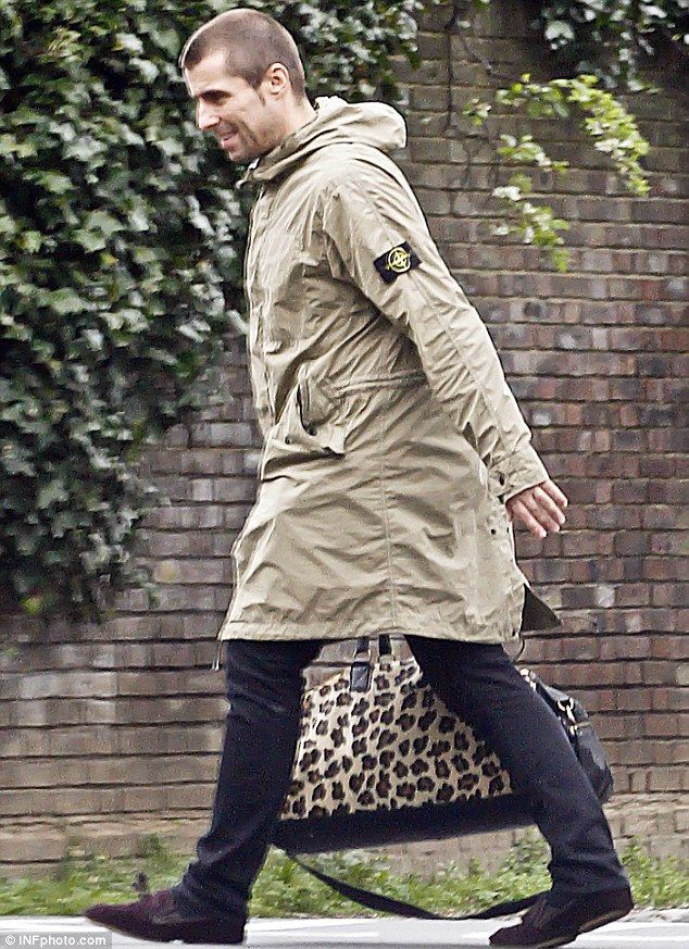 b9f927017c66 Animal magic: Liam dressed in his usual look for the day as he wore a Stone  Island parka and a pair of black trousers