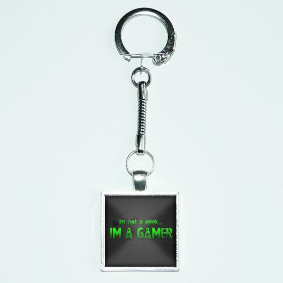 I'm Not A Geek I'm A Gamer picture placed in the setting of your choice of 25mm X 25mm or 20mm X 20mm sealed with glass.  The pendant is attached to a silver keychain.