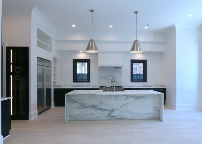 A Marble Island In A White Contemporary Kitchen We Designed With A Marble Island An Contemporary Kitchen Design Contemporary Kitchen White Contemporary Kitchen