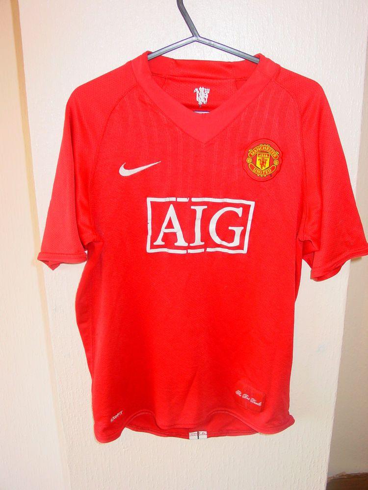 3b2fa1f2dae manchester united nike kids football shirt aig on front