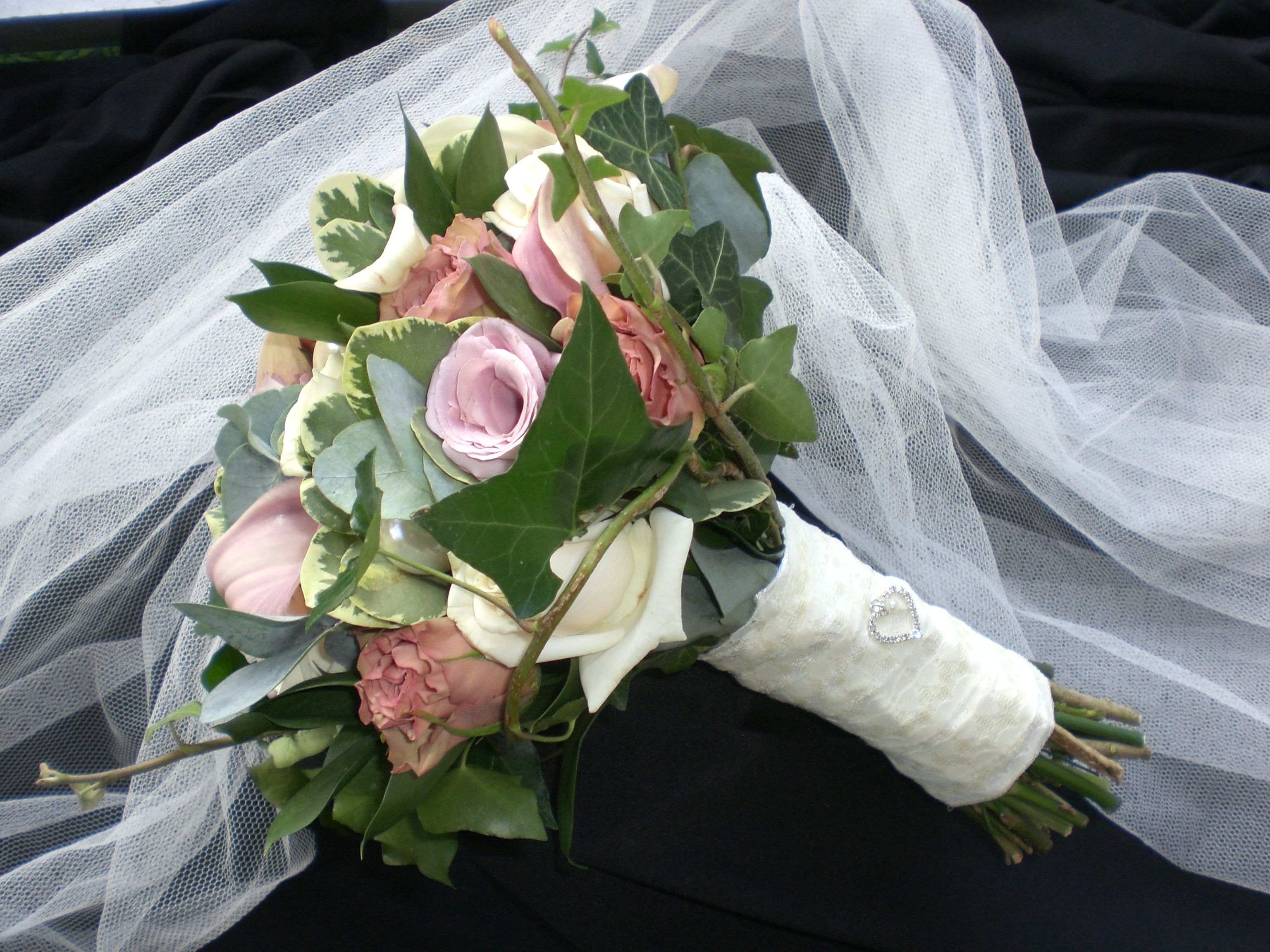 One of our own designs.. vintage inspired with lace, pearl and brooch detailing. See more at www.flowerbox-leicester.co.uk