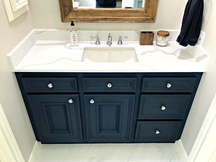 Marble Look Quartz Counters With A Rectangle Undermount Sink And Dark Blue Vanity See Al Blue Bathroom Vanity Bathroom Vanity Makeover Painted Vanity Bathroom