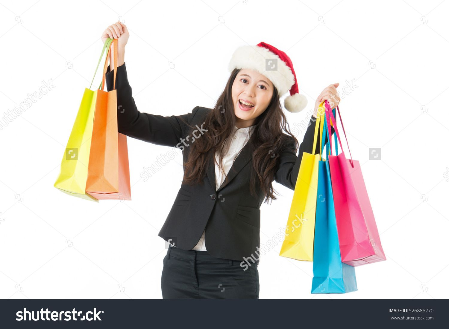 5ccc9f68066f1 Christmas Shopping Business Woman Holding Shopping Bags With Gifts. Happy  And Smiling Wearing Red Santa Hat Isolated On White Background.