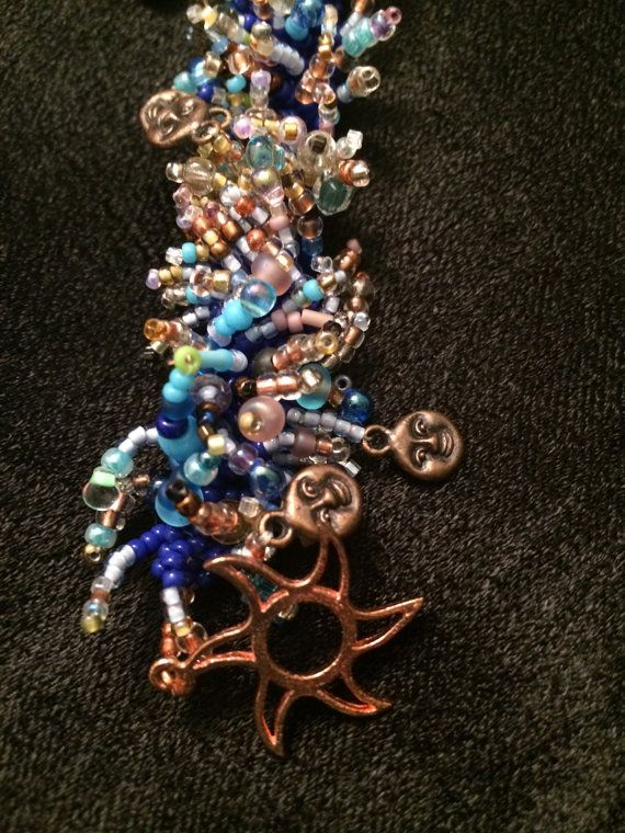 Copper suns and shades of the ocean blue beaded anklet on Etsy, $40.00